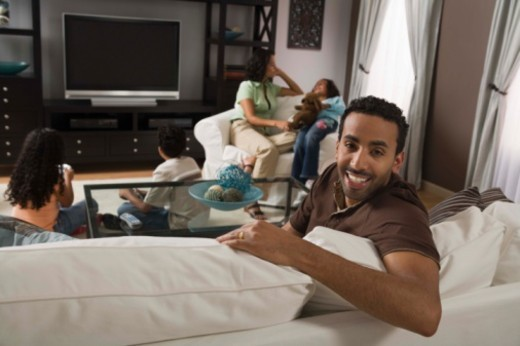 Family in living room : Stock Photo