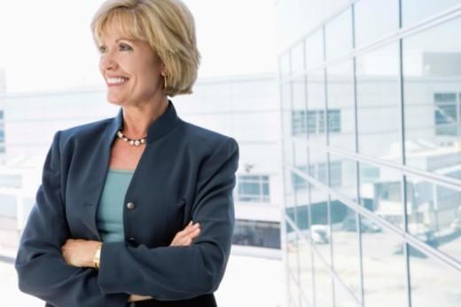 Stock Photo: 1557R-384165 Businesswoman by window