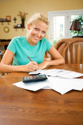 Stock Photo: 1557R-384548 Woman paying bills
