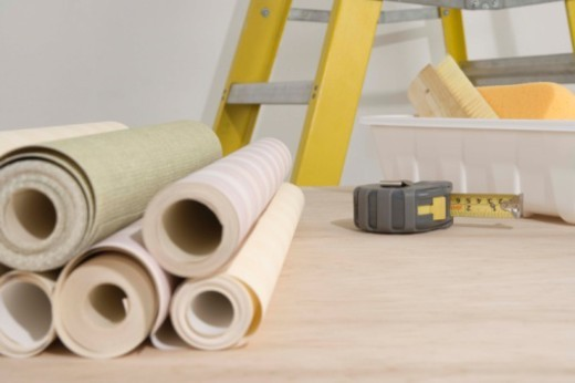 Stock Photo: 1557R-384764 Rolls of wallpaper by ladder