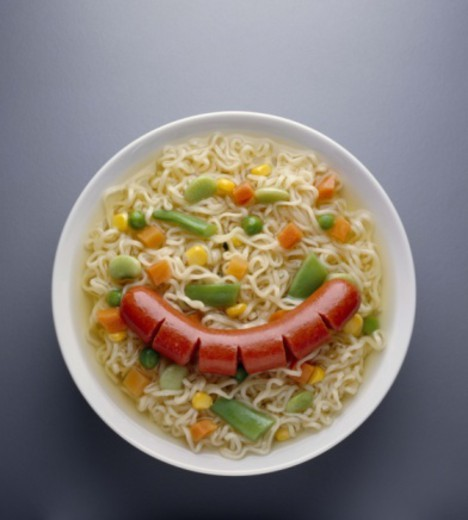 Ramen noodle soup topped with hot dog and vegetables : Stock Photo
