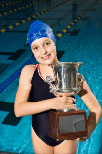Swimmer posing with trophy : Stock Photo