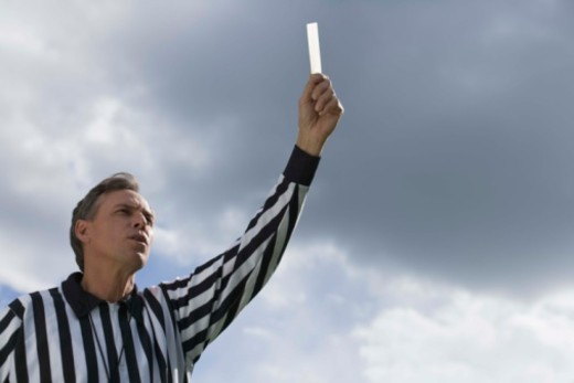 Stock Photo: 1557R-388660 Referee with yellow card