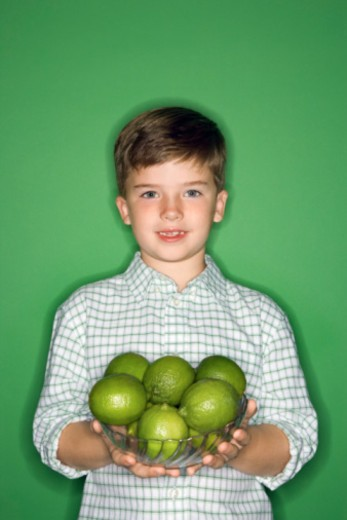 Stock Photo: 1557R-390008 Boy posing with bowl of fruit