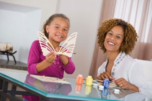 Stock Photo: 1557R-390732 Mother and daughter doing arts and crafts