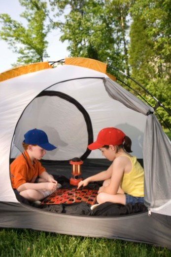 Stock Photo: 1557R-390986 Children playing checkers inside tent