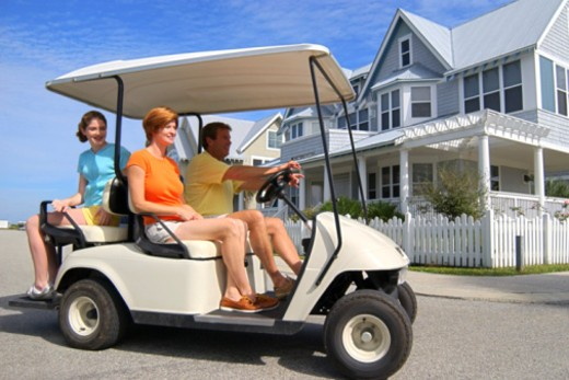 Stock Photo: 1557R-391089 Family driving in golf cart