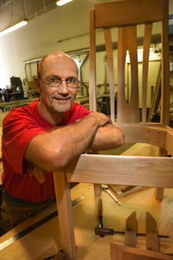 Craftsman posing in workshop : Stock Photo
