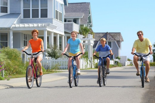 Family riding bicycles : Stock Photo