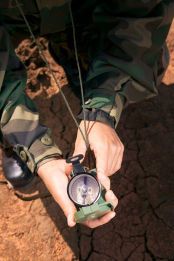 Stock Photo: 1557R-391680 Hands of soldier holding compass