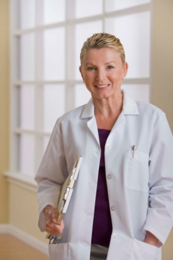 Stock Photo: 1557R-391872 Portrait of doctor with clipboard