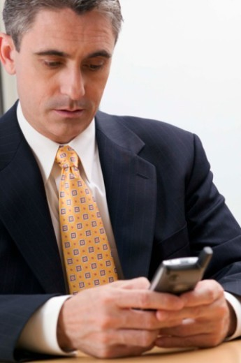 Stock Photo: 1557R-392375 Businessman with personal digital assistant