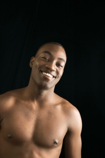 Stock Photo: 1557R-392562 Shirtless man smiling