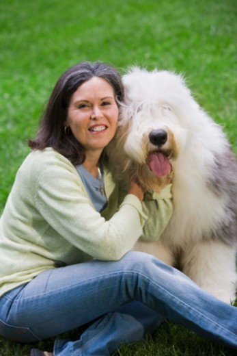 Portrait of a woman with dog : Stock Photo