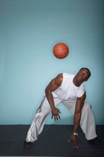Basketball player dodging ball : Stock Photo