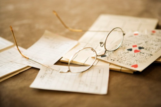 Eyeglasses and papers : Stock Photo