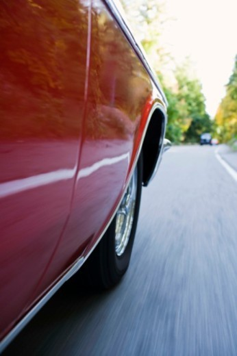Detail of classic car on road : Stock Photo
