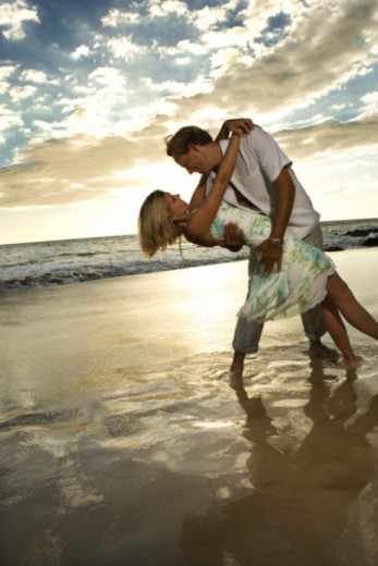 Stock Photo: 1557R-395815 Couple dancing on beach
