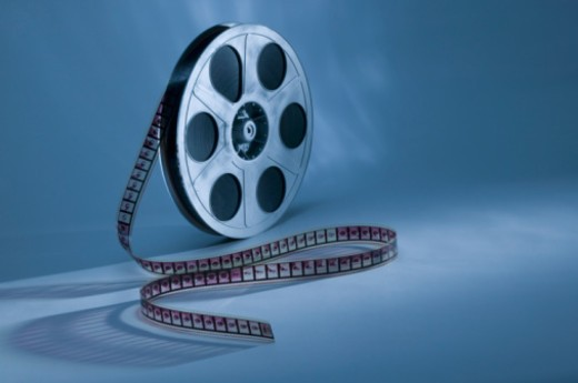 Stock Photo: 1557R-397394 Movie reel on blue background