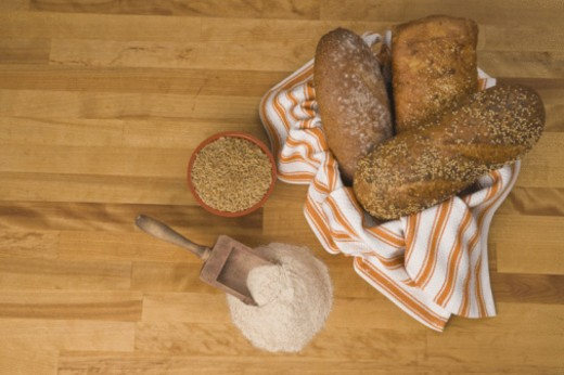 bread with grain and wheat on counter : Stock Photo