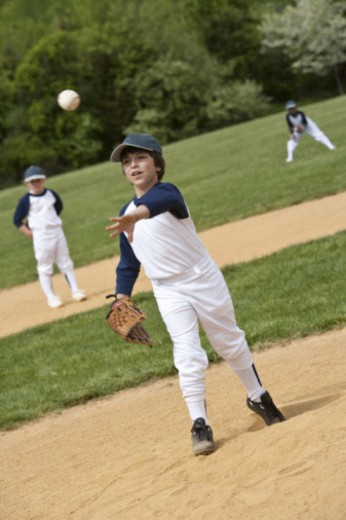 Youth league team playing ball : Stock Photo