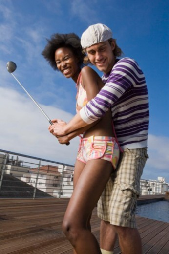 Stock Photo: 1557R-399469 Couple flirting with golf club
