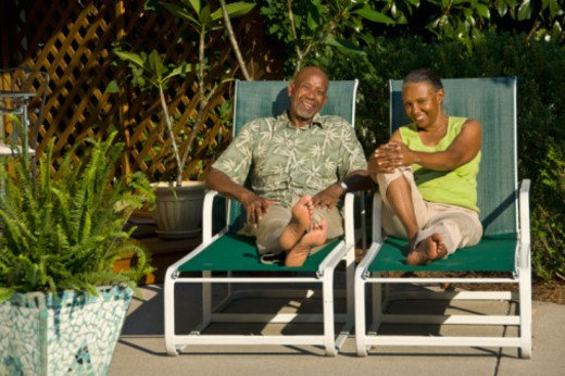 couple in lounge chairs : Stock Photo