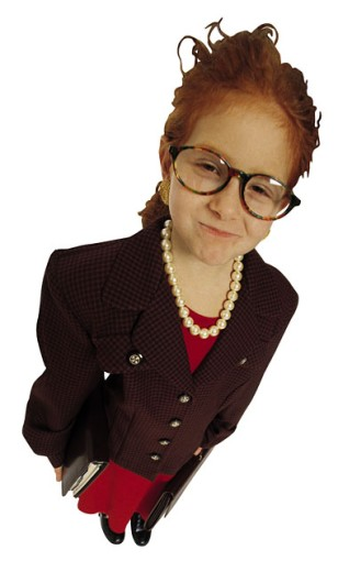 Girl dressed up as businesswoman : Stock Photo