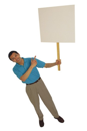Man holding sign and pointing : Stock Photo