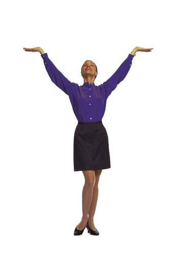 Woman posing with arm raised : Stock Photo