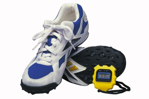 Running shoes and stopwatch : Stock Photo