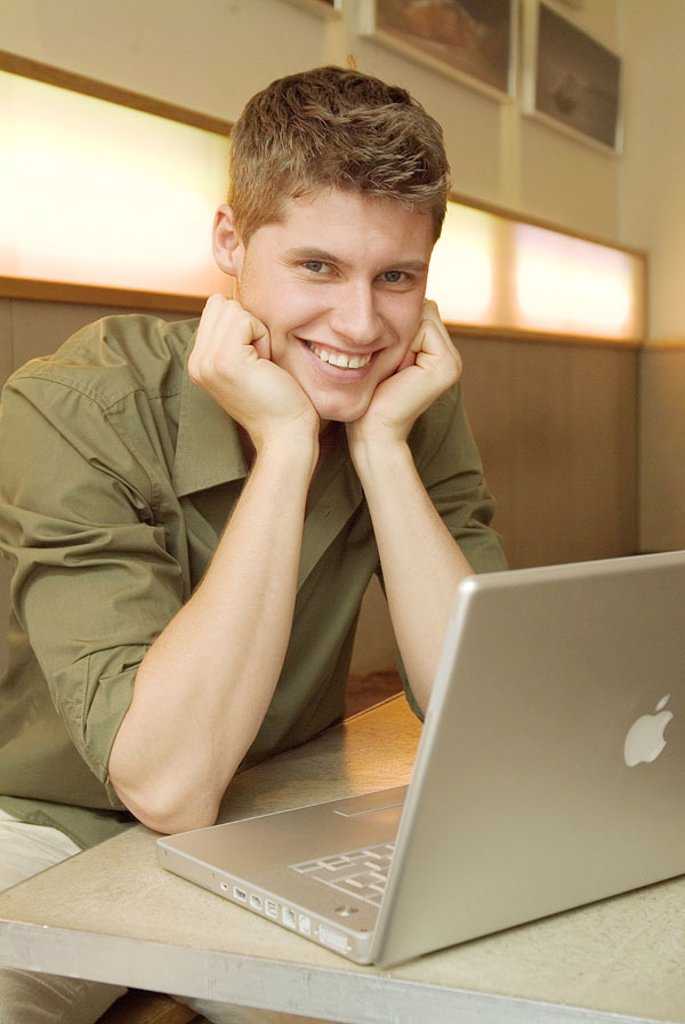 Man, young, head, resting, laptop,  Cafe, sitting,  no property release!,  Series, 20-30 years, dark-haired, leisure time, Lifestyle, pub, cafeteria, indoors, table, resting, computers, works, learning, internet, internet access, Internetsurfen, chatten, : Stock Photo