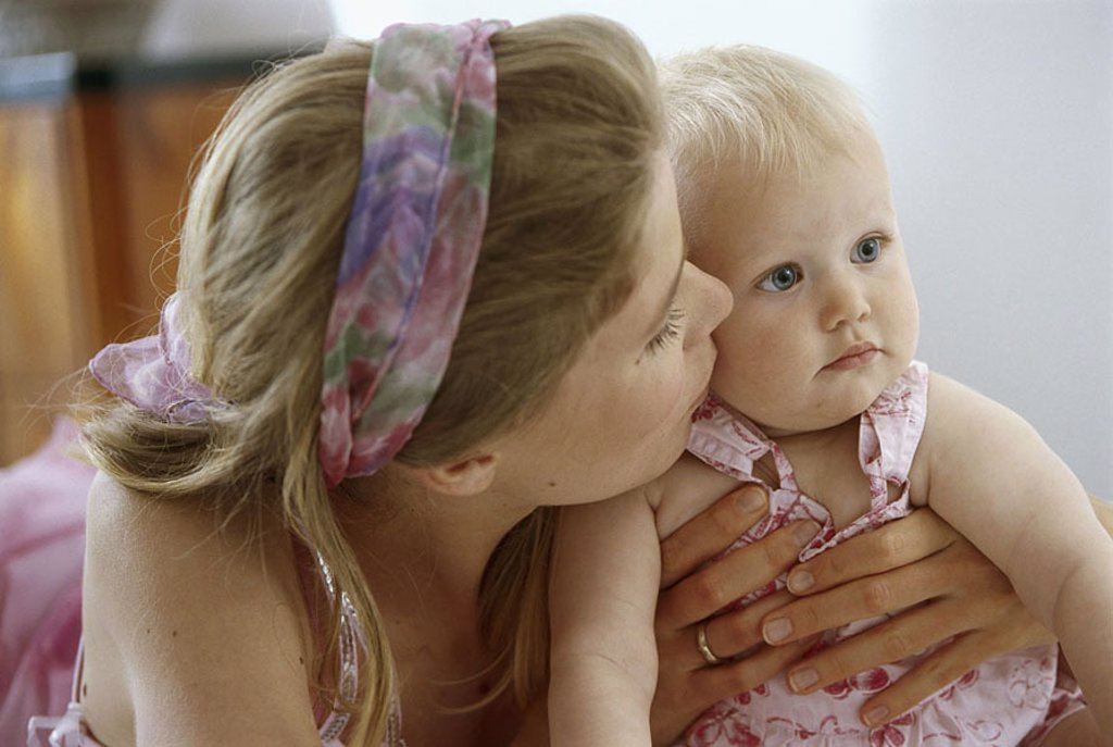 Mother, baby, holds, cuddles, portrait, people, woman, young, 20-30 years, parent, motherhood, child, toddler, infant, 1-2 years, blond, gaze at the side, affection, tenderness, welfare, proximity, caress, kisses indoors, : Stock Photo
