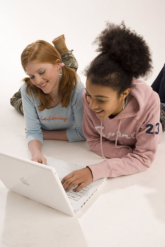 Stock Photo: 1558-108677 Girls, two, nationalities, different, laptop, Internetsurfen, cheerfully, no property release, series, people, 10-15 years, 13 years, teenagers, teenager-girls, friends, floor, lies, computers wearable, data input, data processing, internet, Chatten, lear