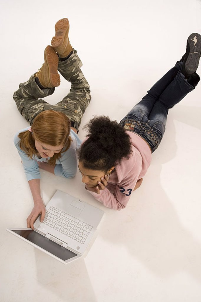 Girls, two, nationalities, different, laptop, Internetsurfen, cheerfully, from above, series, people, 10-15 years, 13 years, teenagers, teenager-girls, friends, floor, lies, computers wearable, data input, data processing, internet, Chatten, learns, toget : Stock Photo