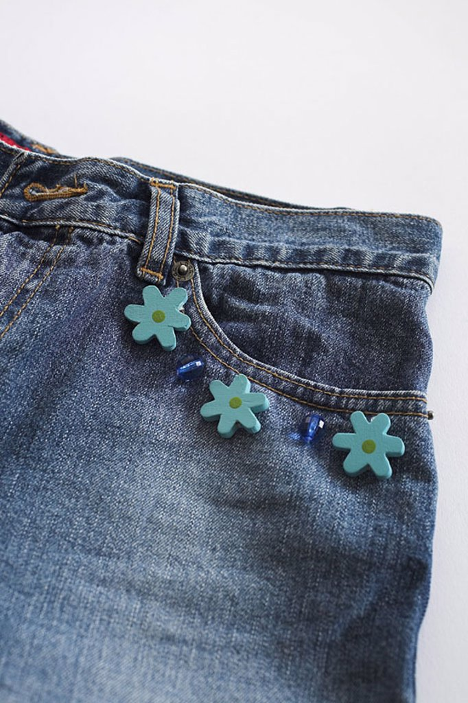 Pants, jeans, detail, ornamentation, application, clothing, handicraft, Näharbeiten, jeans, bag, pants-bag, border, pearls, ornament-pearls, flowers, little flower, ornament-flowers, blue, aufgenäht, trend, style, fashion, peps up, creativity, quietly lif : Stock Photo
