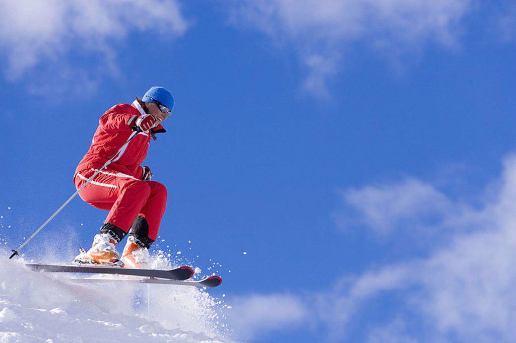 Stock Photo: 1558-111298 Track, ski-chauffeuse, jump, cloud-heavens, ski-track, ski-departure, people, woman, 30-40 years, ski-clothing, sun glass, skiing, Carven, dynamics, speed, skill, proficiency, Fun, sport, alpine-sport, skiing, activity, fitness, hobby, leisure time, vacat