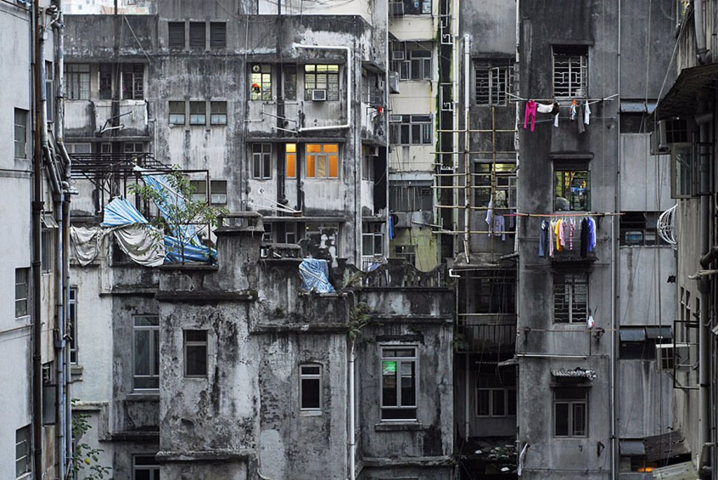 Block of flats, balconies, facades, windows, air-conditioning, clothes lines, laundry, gray, dismal, unkempt, floors, detail, twilight, illumination, Asia, China, 03/2006 : Stock Photo