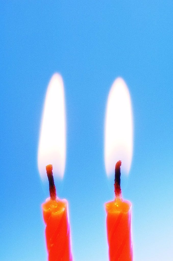 Candles, orange, detail, burn series, wax candles birthday-candles flames candlelight candlelight, symbol, birthday, party, happiness, festivity, fact-reception, celebrates background blue, : Stock Photo