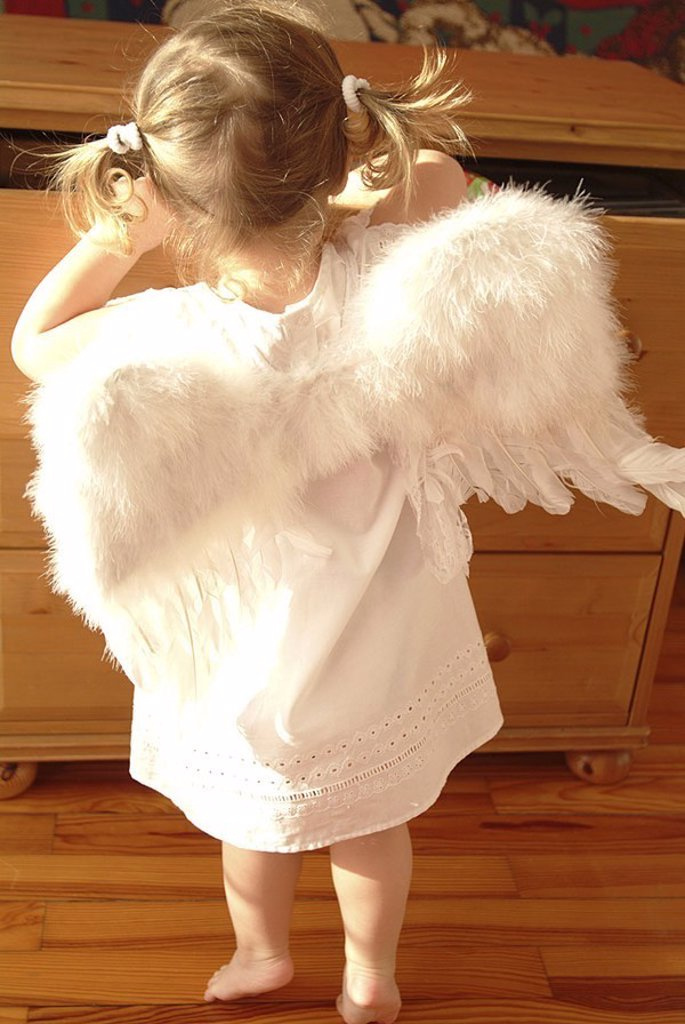 Stock Photo: 1558-119042 Dresser, child, girls, braids, little dress, angel-wings, back-opinion, drawer, people, opens toddler, 2-4 years wing barefoot, little angels, angels, plays, seeks, rummages, disguise, outfit, Christmas-like, broached, childhood, Christmas, curiosity, int
