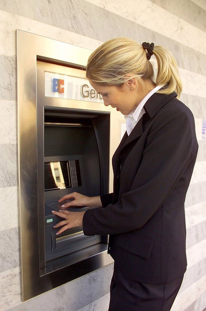 Woman, young, automatic teller, at the side, semi-portrait, : Stock Photo