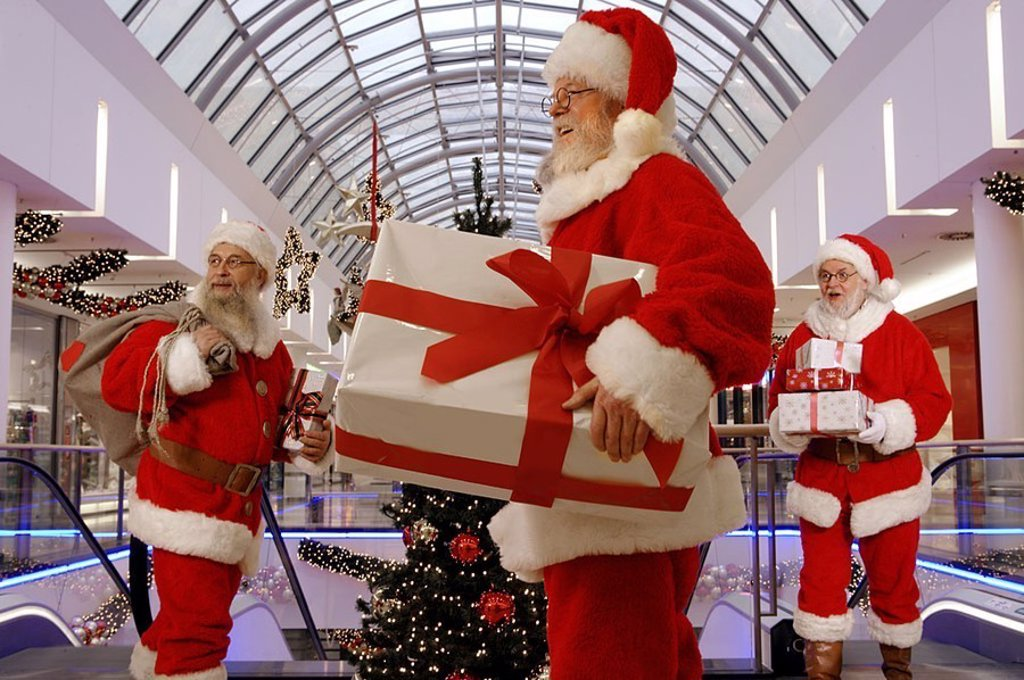 Santa Claus, cheerfully, gifts, holds, stands, shopping center, Christmas, people, men, three, disguise, outfits, glasses, beards, fun, cheerfully, happily, cheerfully, Christmas-gifts, decoration, Christmas-decoration, interior, : Stock Photo