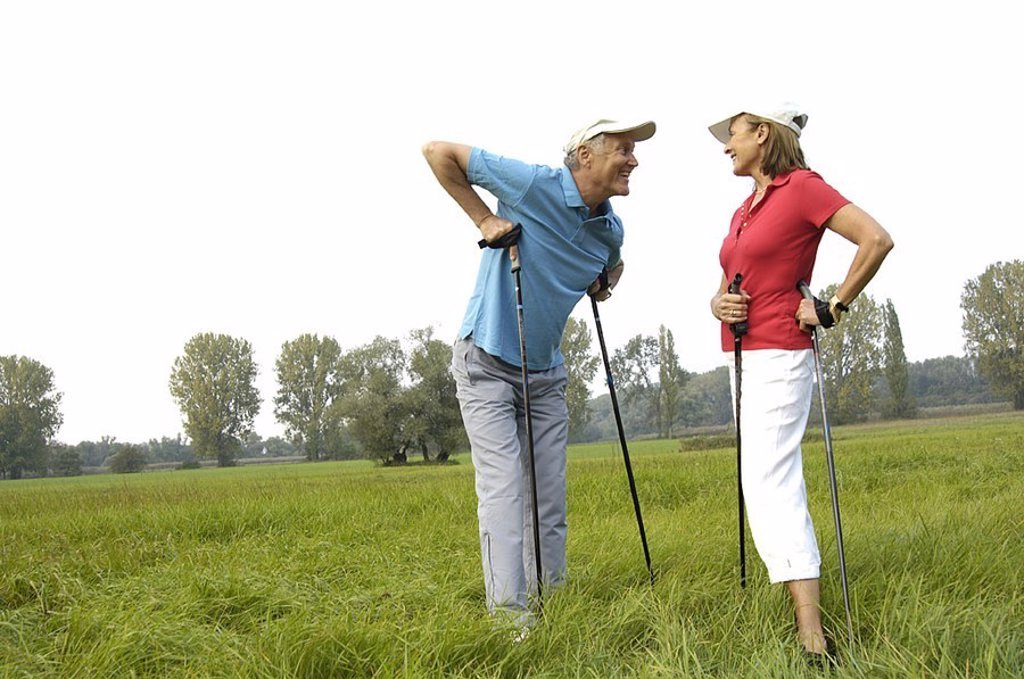 Stock Photo: 1558-122659 Meadow, senior-pair, Nordic Walking, rest, conversation, cheerfully, series, people, 50-60 years, 60-70 years, pair, seniors, Walking, well Age, athletes, sport, activity, fitness, endurance, condition, balance, leisure time, hobby, Lifestyle, concept, he