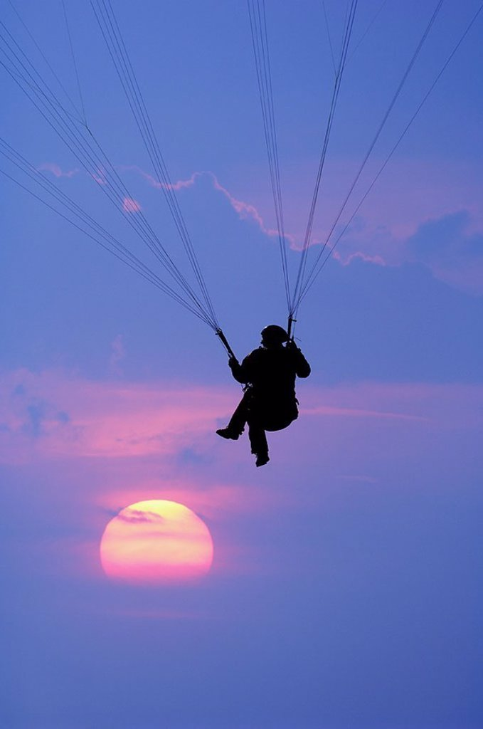 Heavens, blue, Paraglider, silhouette, sunset, athletes, Paragliden, Paragliding, leisure time, vacation, sport, hobby, activity, leisure time-activity, sport, air-sport, aviation, hovers, glides, weightless, freedom-feeling, evening, color-mood, color, b : Stock Photo