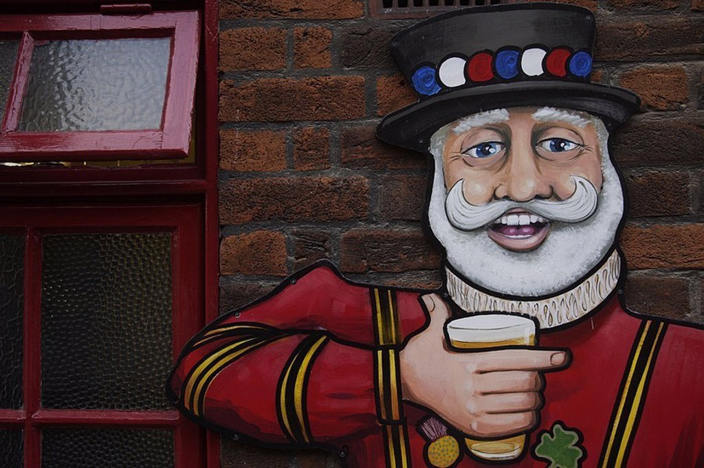 House-wall, windows, figure, detail, pub, pub, wall, brick-wall, selectors, art, painting, merrily, man, cylinders, beard, cheerfully, beer, beer-glass, holds, drinks, shamrock, : Stock Photo