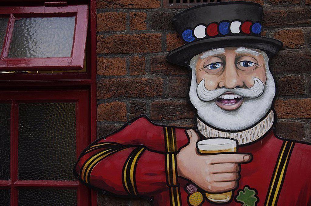 Stock Photo: 1558-124036 House-wall, windows, figure, detail, pub, pub, wall, brick-wall, selectors, art, painting, merrily, man, cylinders, beard, cheerfully, beer, beer-glass, holds, drinks, shamrock,