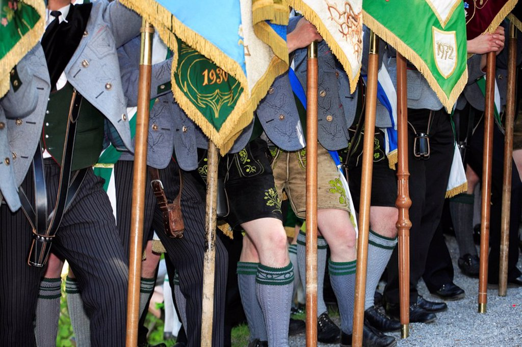 Germany, Bavaria, Fischbachau, birch-stone, Feast of Corpus Christi-day, pilgrims, men, official dress, detail, legs, flags, Upper Bavaria, Leitzachtal, Feast of Corpus Christi-procession, place of pilgrimage, pilgrimage, traditional costum-pilgrimage, pe : Stock Photo