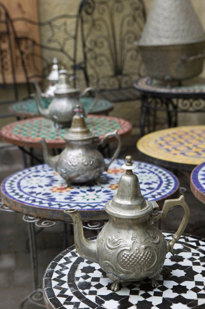Morocco, Fes, Fes El Bali, business, sale, mosaic-tables, tea-pots, city, district, Old Town, ware, traditionally, regional-typically, mugs, metal-mugs, silver-mugs, tables, cafe, cafe-tables, pattern, ornaments, mosaic, colorfully, outside, flag,. Morocco, Fes, Fes El Bali, business, sale, mosaic-tables, tea-pots, city, district, Old Town, ware, traditionally, regional-typically, mugs, metal-mugs, silver-mugs, tables, cafe, cafe-tables, pattern, ornaments, mosaic, colorfully, outside, gefliest, : Stock Photo