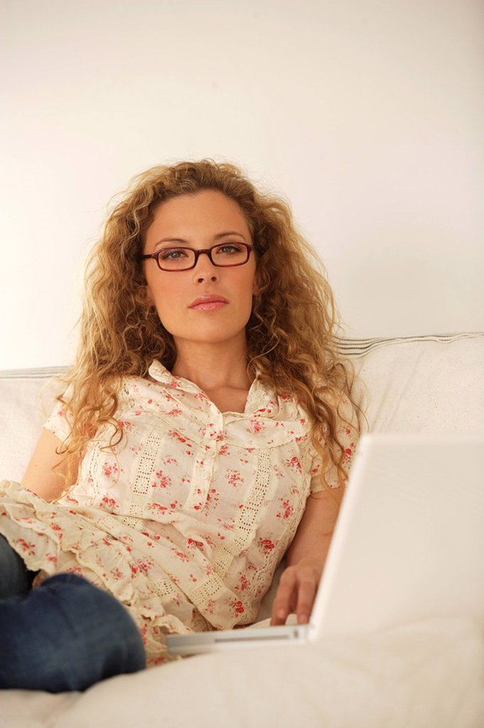 Stock Photo: 1558-137141 Sofa, woman, young, laptop, thoughtfully, series, people, blond, long-haired, curls, lie, sitting, comfortable, casual, computers, data input, data-retrieval, wireless, internet, surf the web, mailing, Chatten, telecommunication, information, interest, sy. Sofa, woman, young, laptop, thoughtfully, series, people, blond, long-haired, curls, lie, sitting, comfortable, casual, computers, data input, data-retrieval, wireless, internet, Internetsurfen, Mailen, Chatten, telecommunication, information,