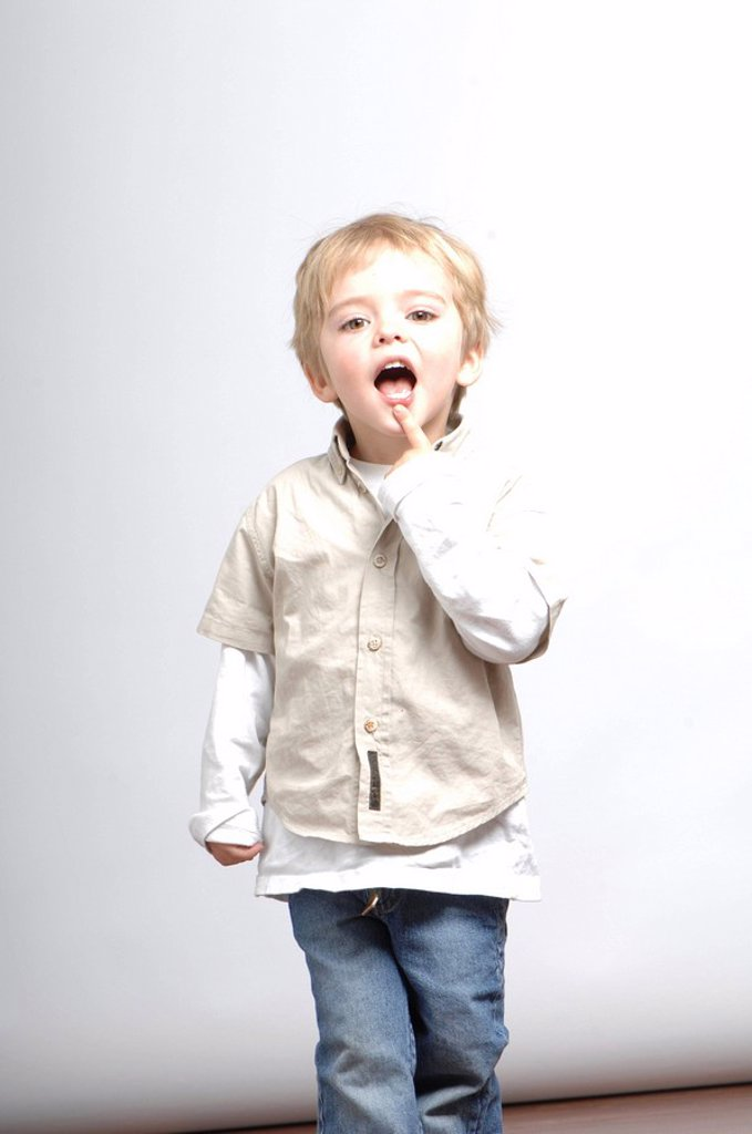 boy, blond, smiling, stands, gesture, series, people, child, toddler, 2-3 years, watching, camera, shirt, beige, jeans, expression, curious, know-thirsty, smile archly, nicely, studio, interior, : Stock Photo